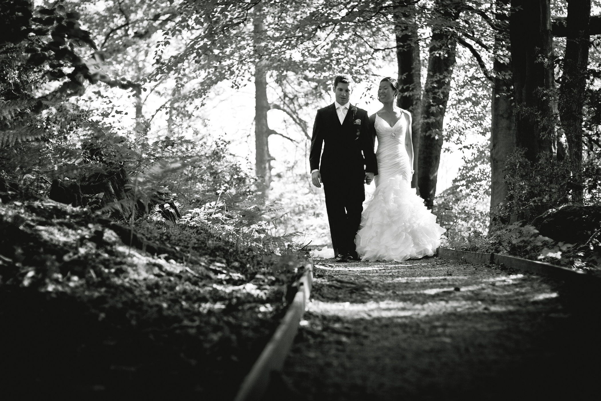 Stunning And Creative Wedding Photography In Cumbria Walking Through The Woods Of Grounds Venue Linthwaite House