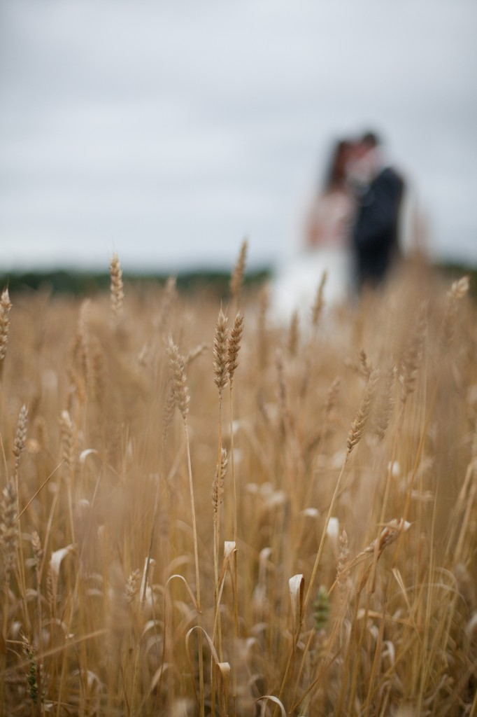Bride and groom in a field, Creative Modern Wedding Photography