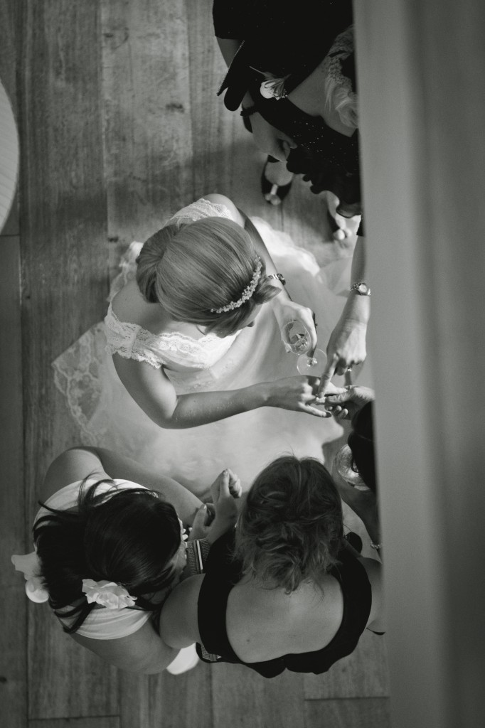 Friends of the bride pointing to the bride's ring. Lancashire Wedding Photographer Karli Harrison