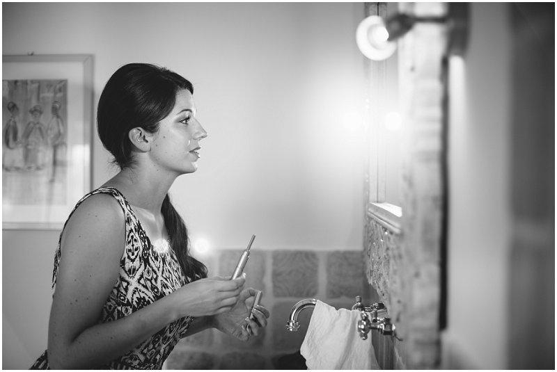 Bride doing makeup during bride prep