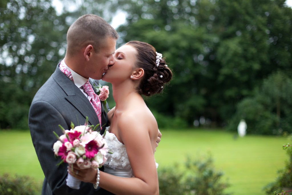 A bride and groom kissing during couples portraits at Higher Trapp