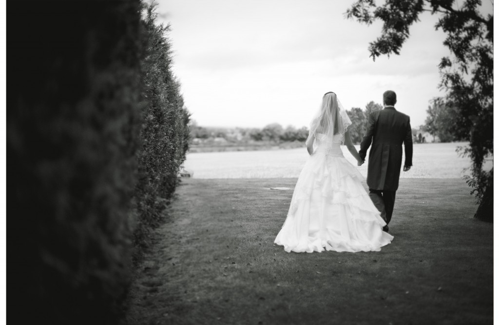 Bride and groom walk hand in hand. Lancashire Wedding Photography