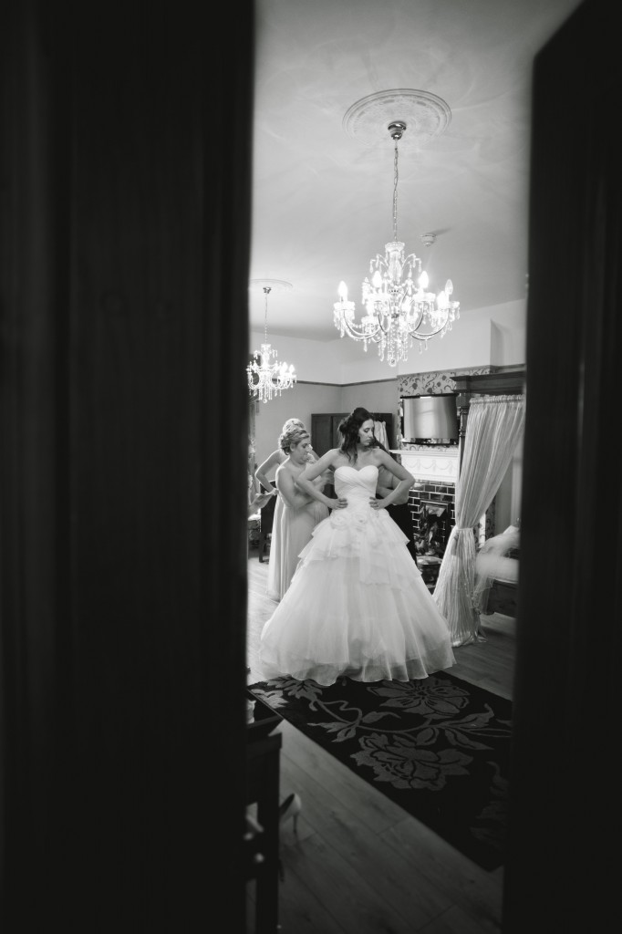 A bride from the doorway of the bridal suite. West Tower Wedding Photography