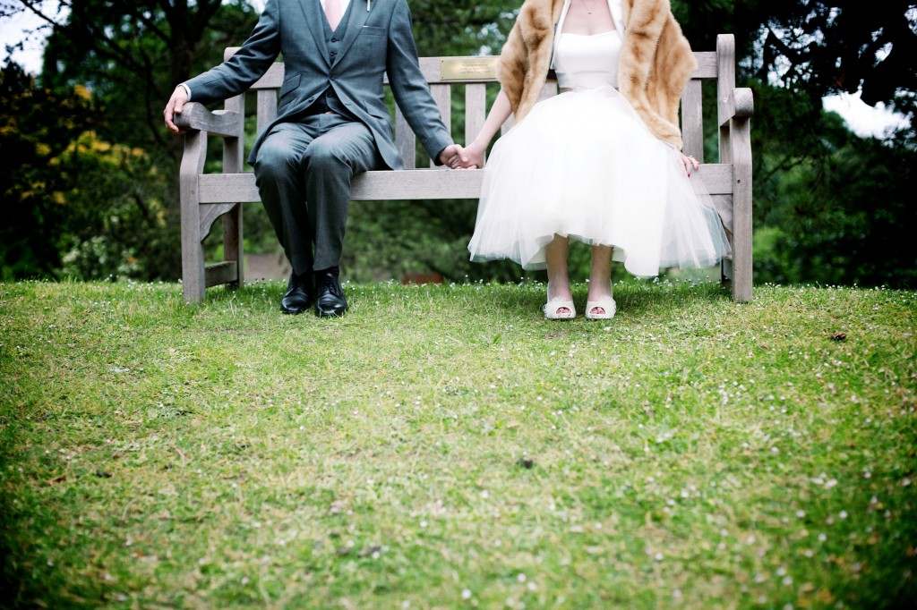 Kew Gardens wedding photographer, couple sitting on a bench