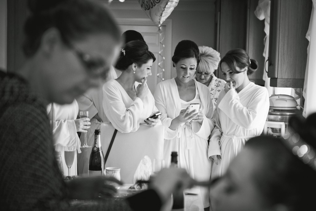 Bridesmaides and out of focus bride in the foreground - Suites Hotel Wedding Photographer
