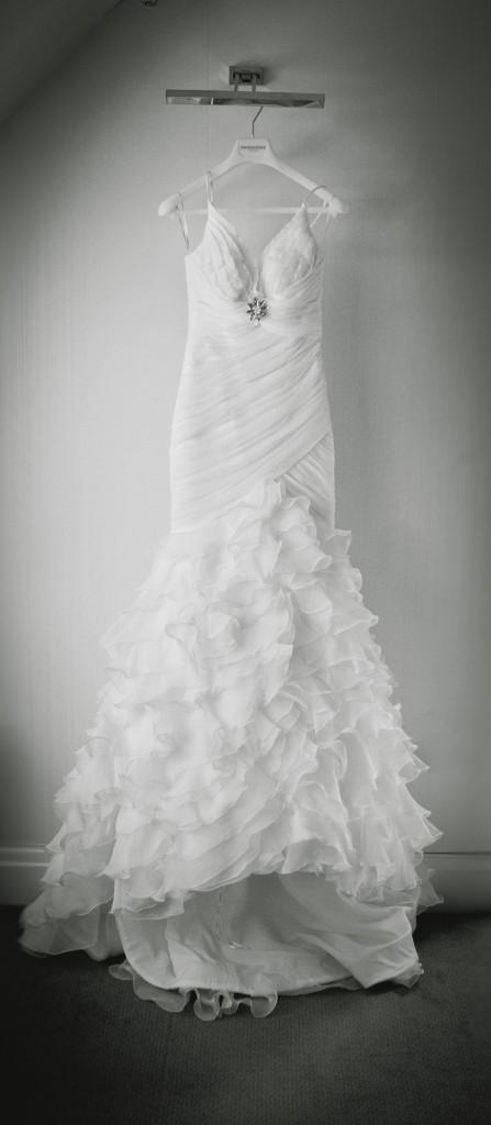 A detail photograph of a bride's stunning dress. Beautiful wedding photography