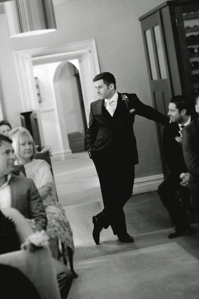 A groom hanging out, waiting for his bride to arrive. Beautiful professional wedding photography, Linthwaite House Hotel