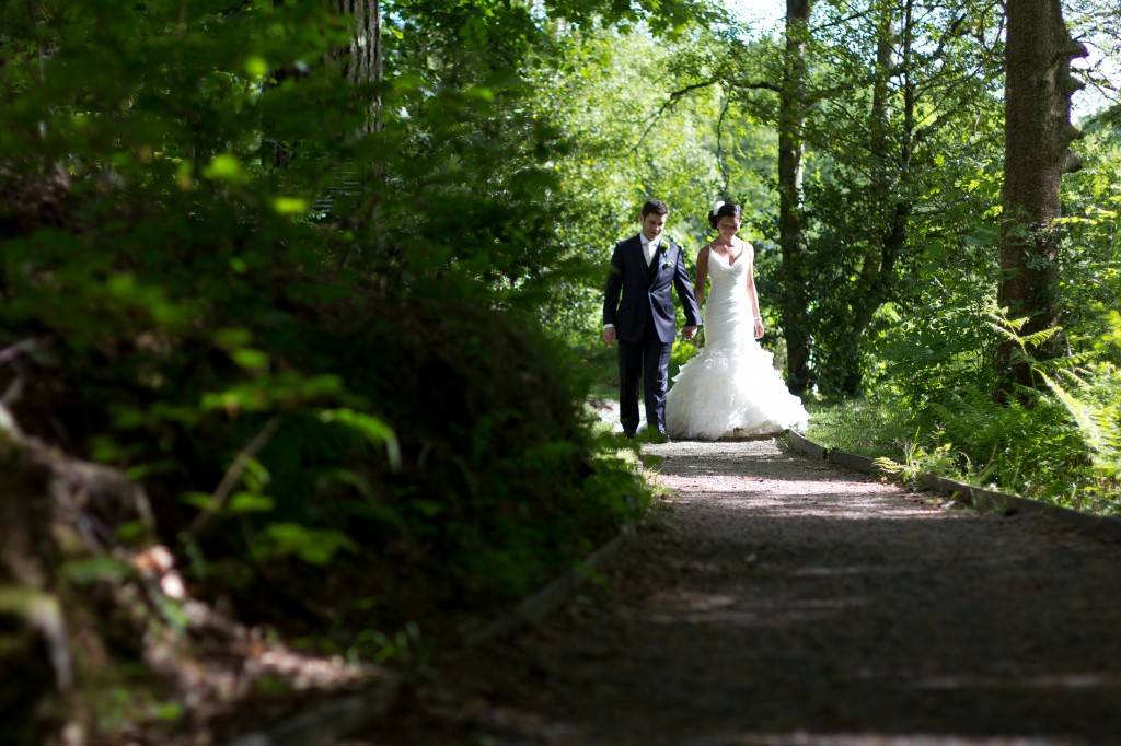 Walking through the woods during couples portraits in Cumbria, Lancashire