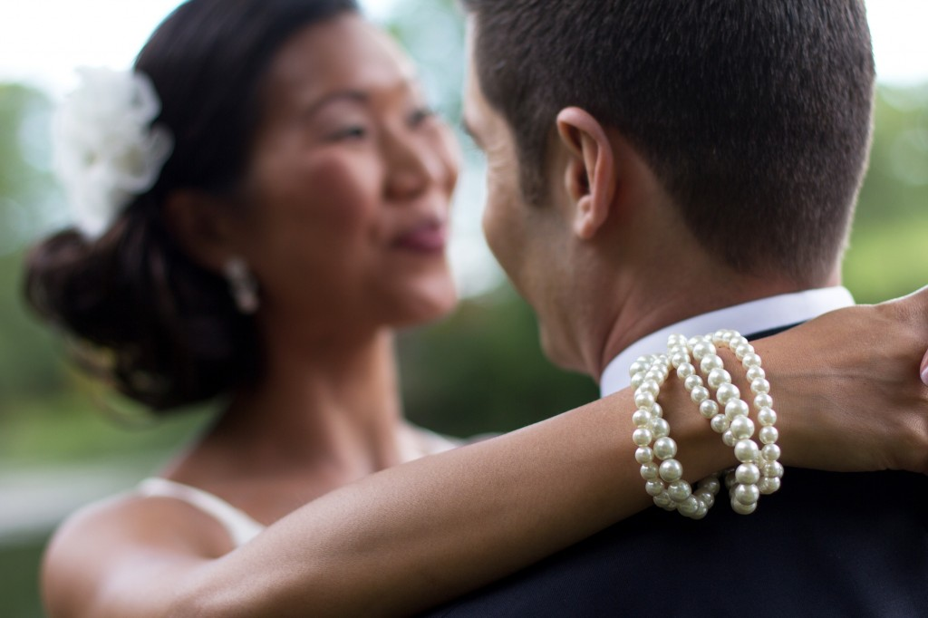 Bride's pearl bracelets. Stunning and creative wedding photography in Cumbria