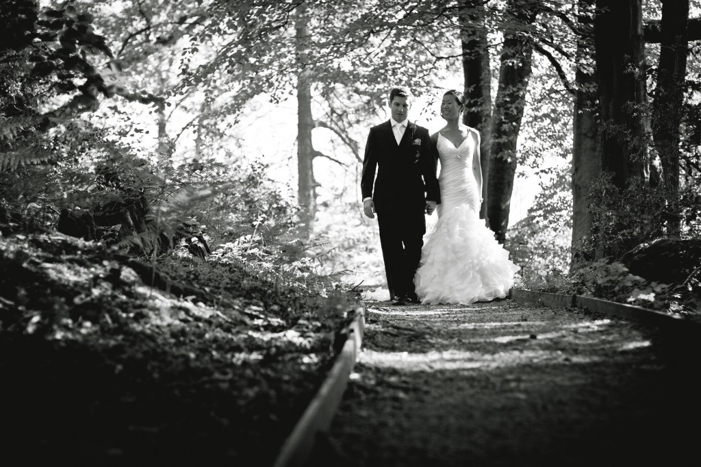 Walking through the woods of the grounds of the stunning wedding venue Linthwaite House, Cumbria