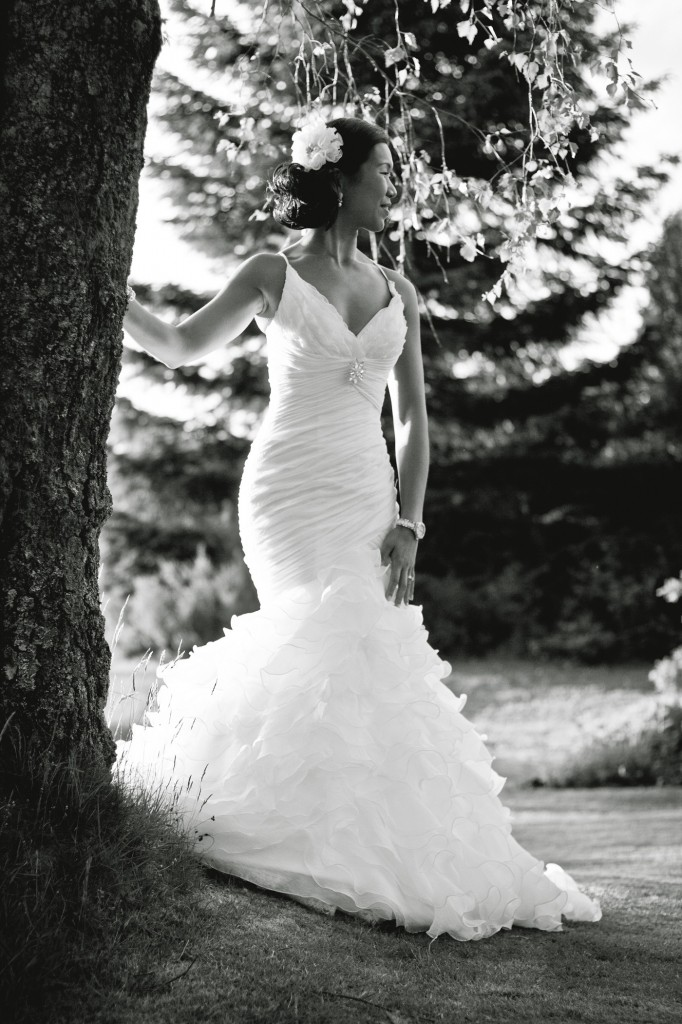 Bride standing against a tree with the sun to her back, Lake District Wedding Photography