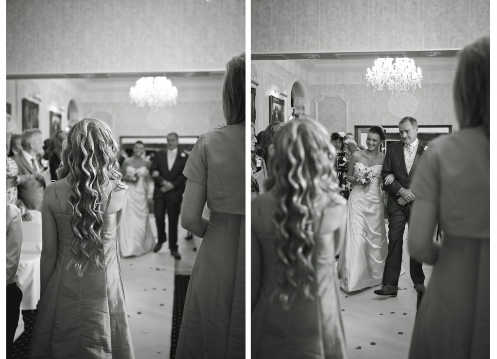 Walking down the aisle with her father at the Country House Hotel