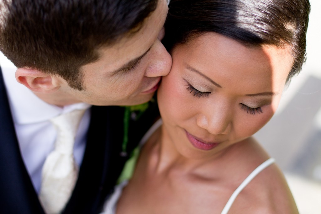 Close up of a tender kiss from a groom to his new bride. Wedding Photography