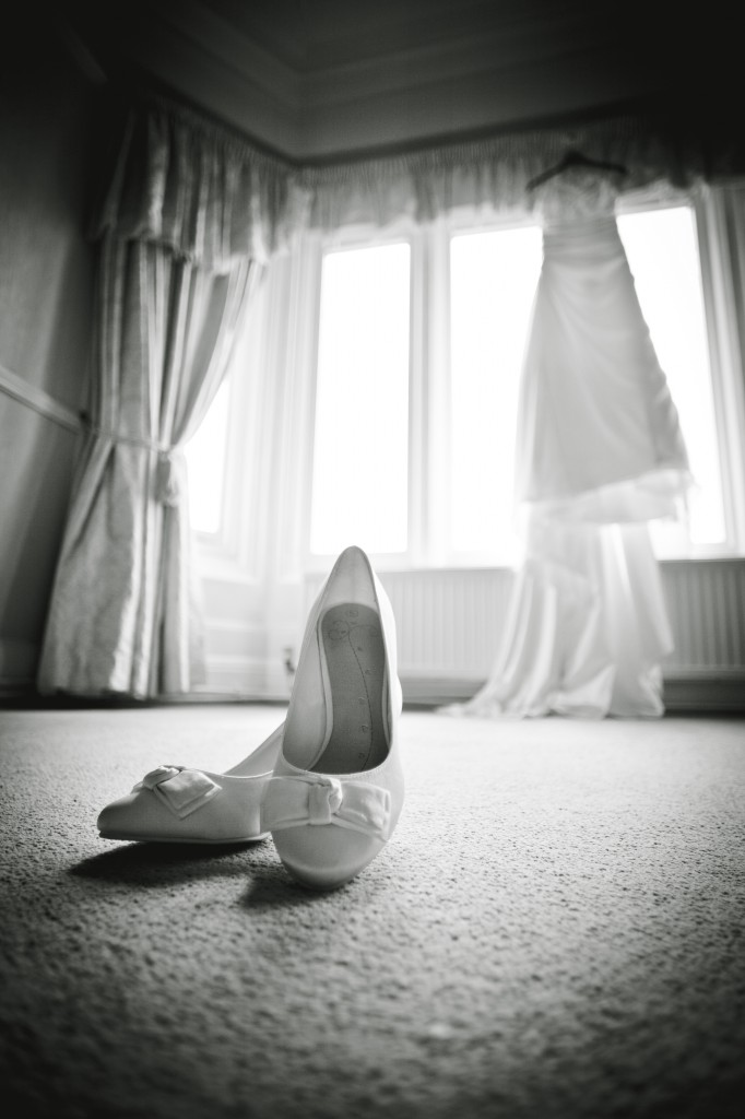 Wedding bridal preparations, detailed shot of shoes and dress