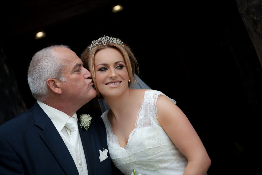 Father of the bride kisses his daughter on the cheek, beautiful wedding photography Lancashire