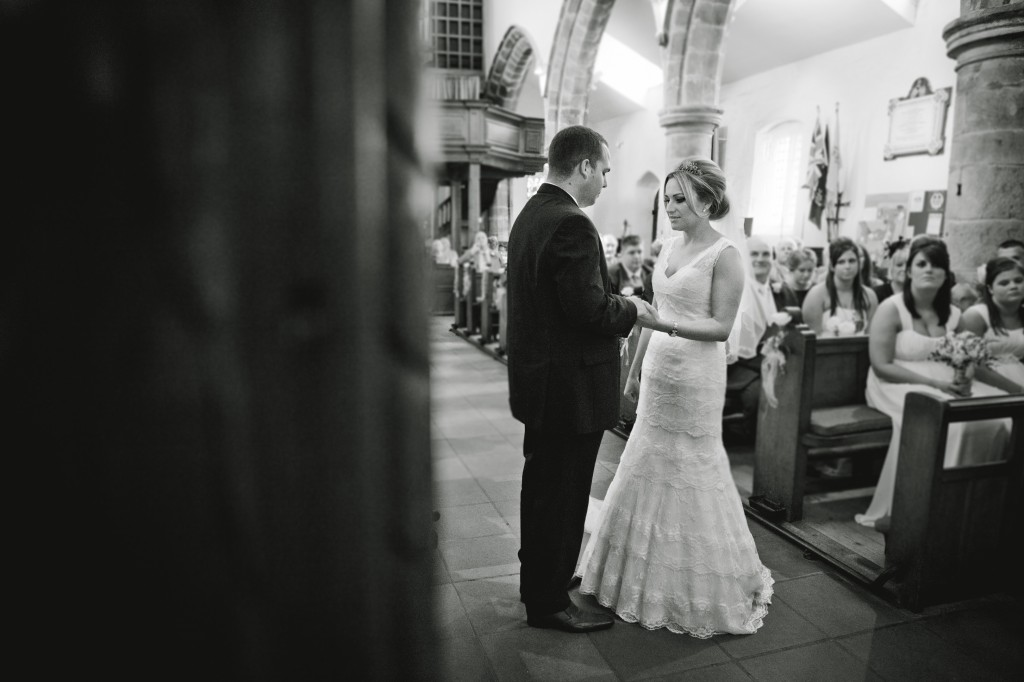 Exchanging of rings- bride and groom in church, beautiful wedding photography Lancashire