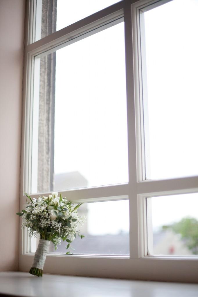 Beautiful wedding flowers on a window ledge