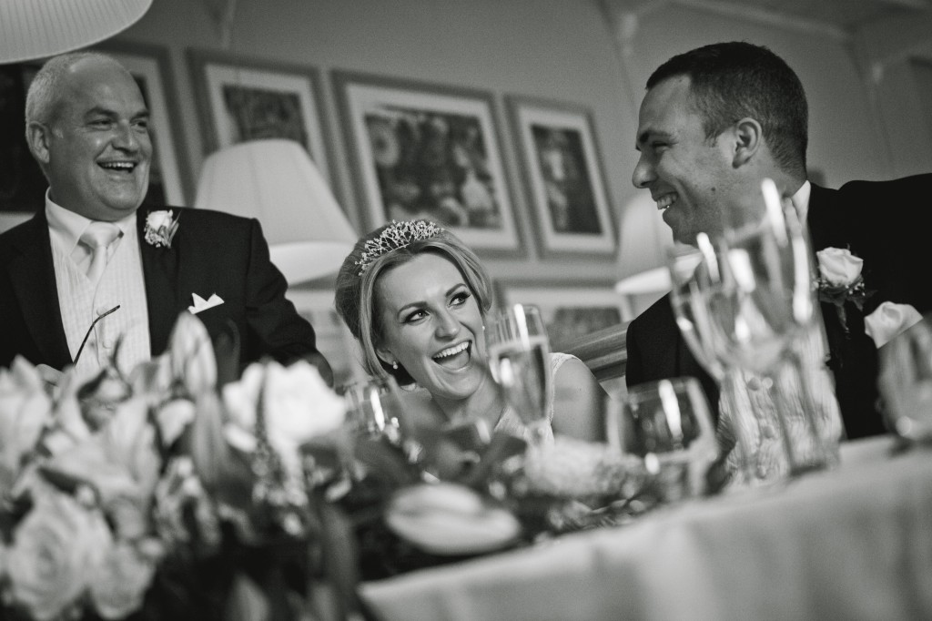 Black and white shot of Father of the Bride, the bride and groom at the top table, Lancashire photography