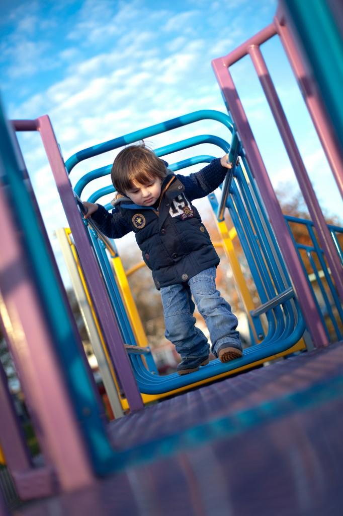 Playing on the playground at Ashton Park, Preston in Lancashire