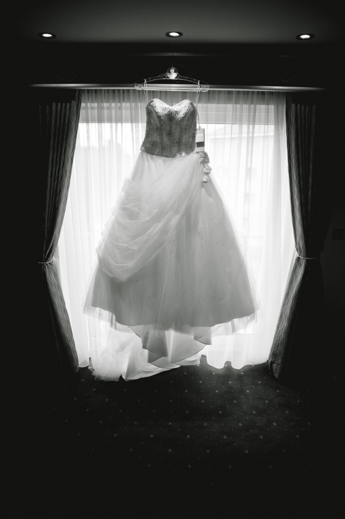 Gorgeous Wedding Dress Hanging in Window - Liverpool Suites Hotel Photographer