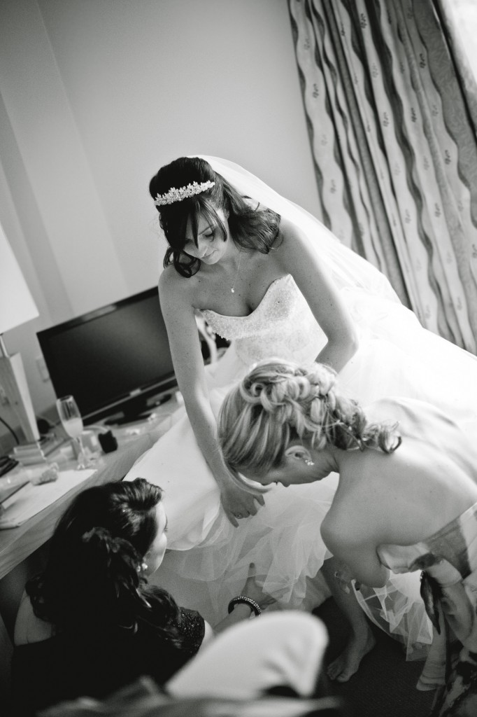 Bride Getting Into Dress and Shoes - Suites Hotel Wedding