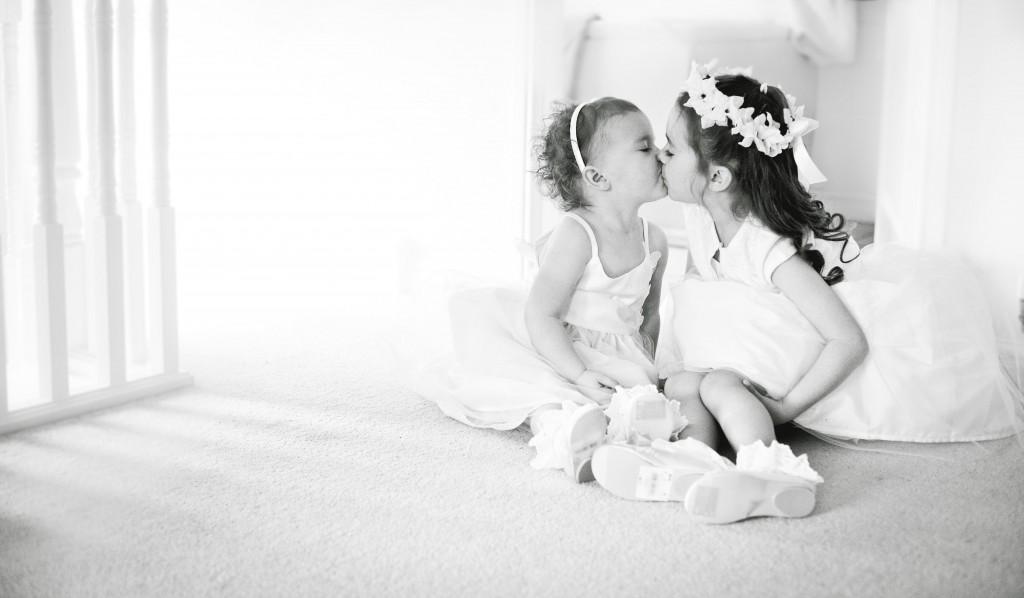 Cute Little Bridesmaids Share a Kiss - Wirral Wedding Photographer