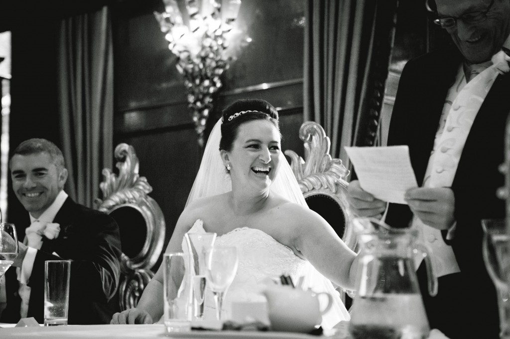 Bride Laughing at Speeches - Alicia Hotel Wedding Photographer