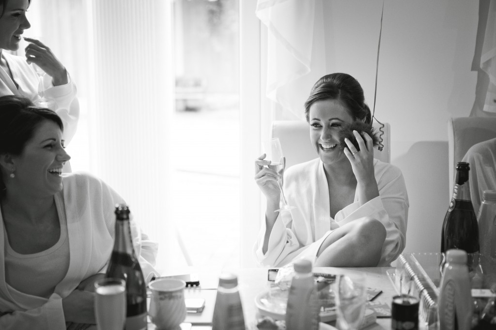 Laughing Bridesmaid During Wedding Preparation   Suites Hotel Wedding Photography