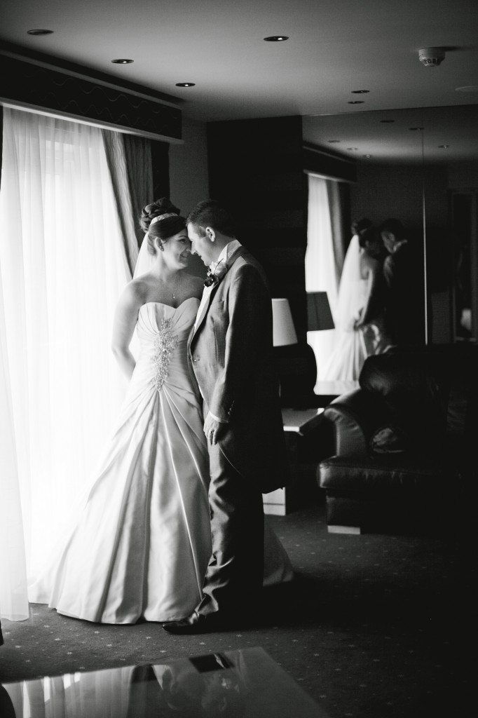 Couple Touching Foreheads in Liverpool   Suites Hotel Wedding Photographer