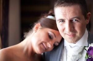 Bride Lays Head on Groom's Shoulder   Suites Hotel Wedding Photographer