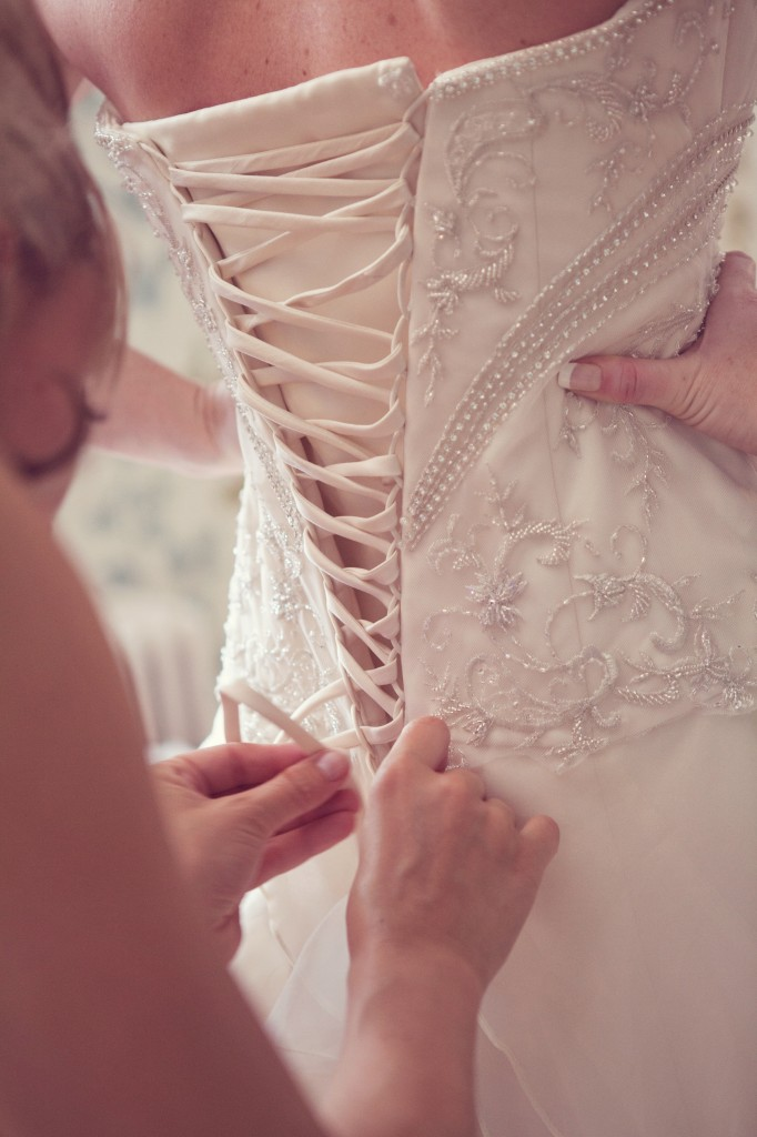 Getting into the wedding dress at Northop Hall North Wales