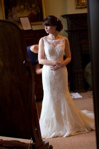 Bride standing in bridal suite of Rowton Castle, Shropshire Wedding Photography