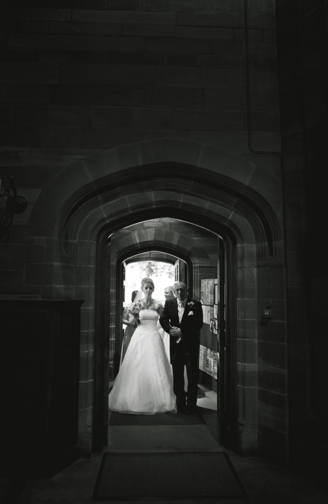 Bride walking into the church with her father. Ashfield House Wedding Photography