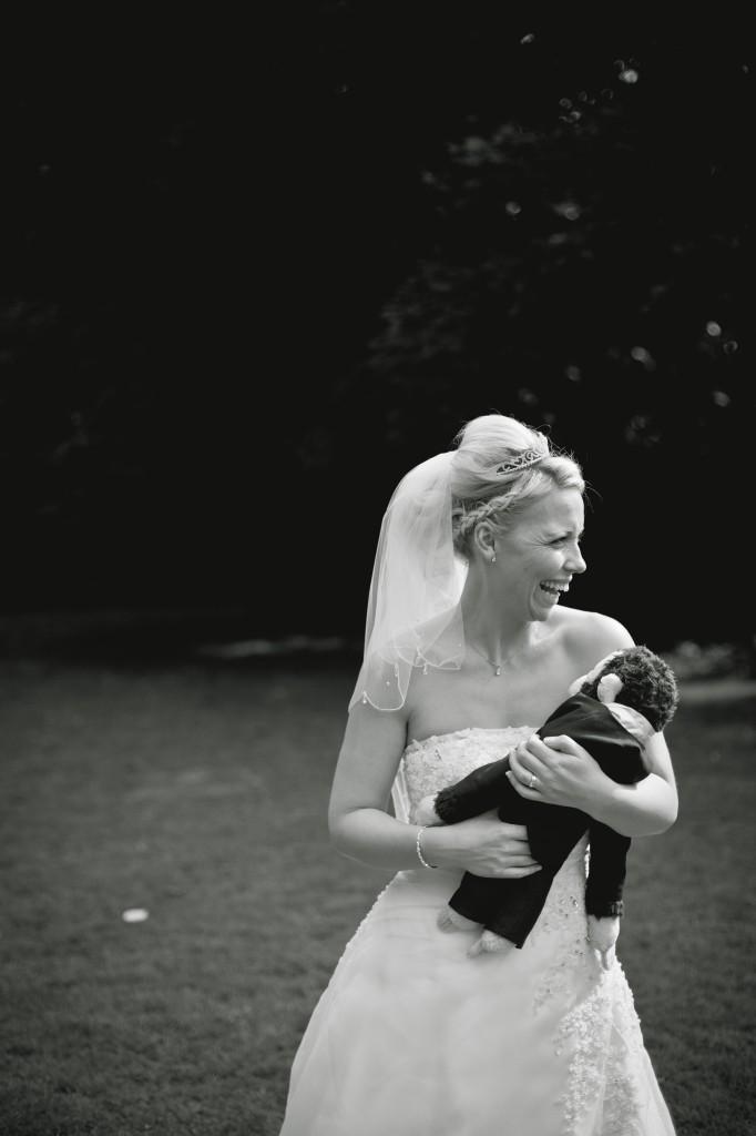 The beautiful bride, cuddling her monkey. Ashfield House, Lancashire wedding photographer
