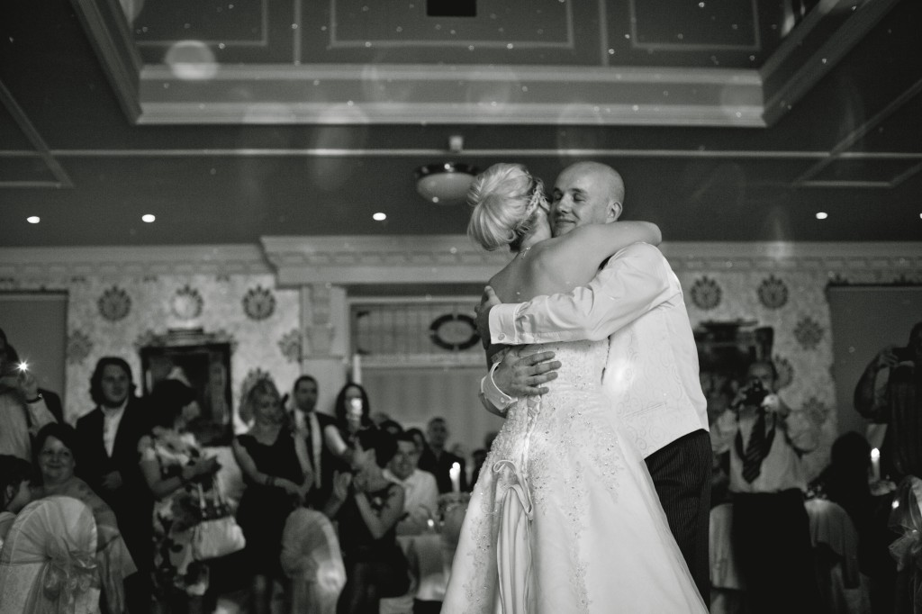 Wedding Photography - the first dance. Bride and groom embrace. Lancashire