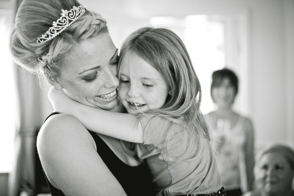 Bride hugs her bridesmaid, wedding photography Ashfield House