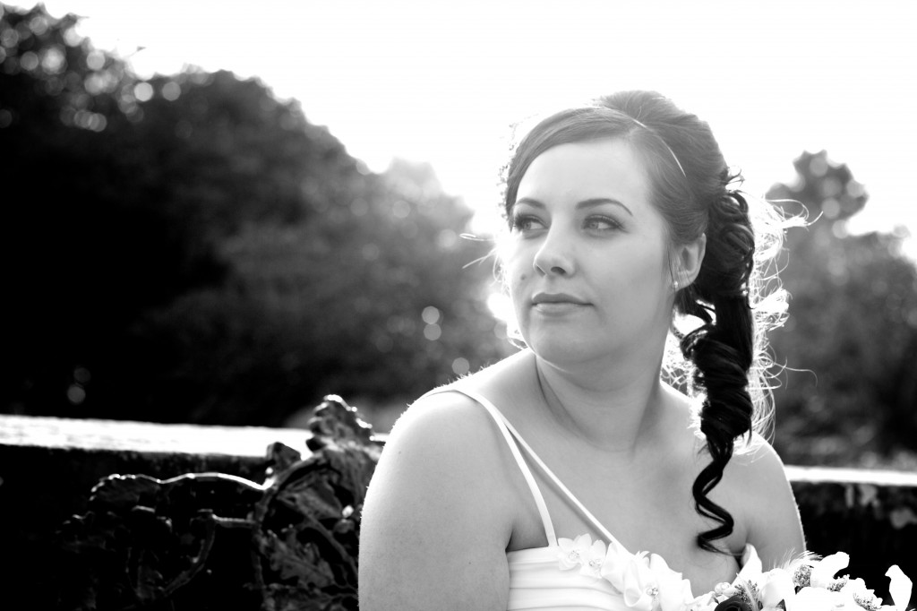 A bride sits on a bench at Dalston Hall, Cumbria