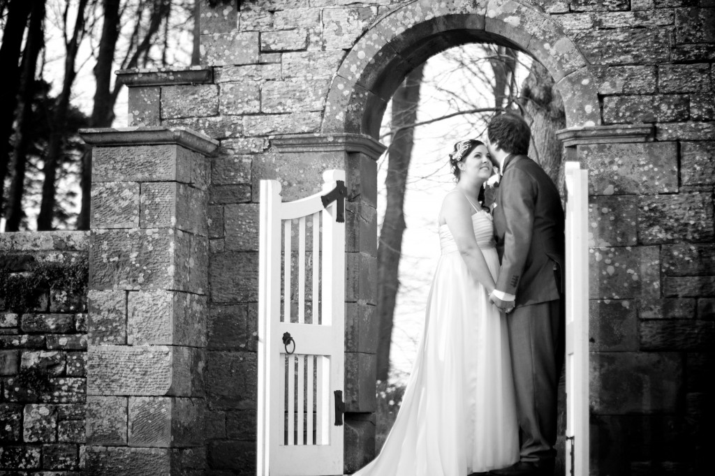 Embracing in a gateway, the gardens of Dalston Hall, Cumbria