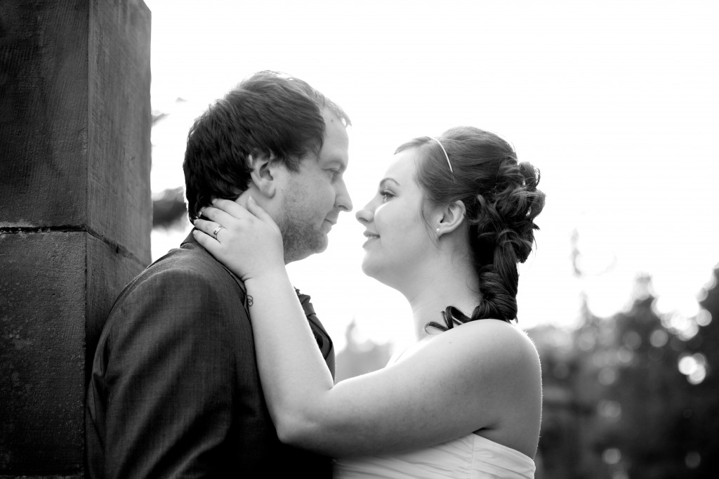 Couple at Dalston Hall embracing after their wedding vows