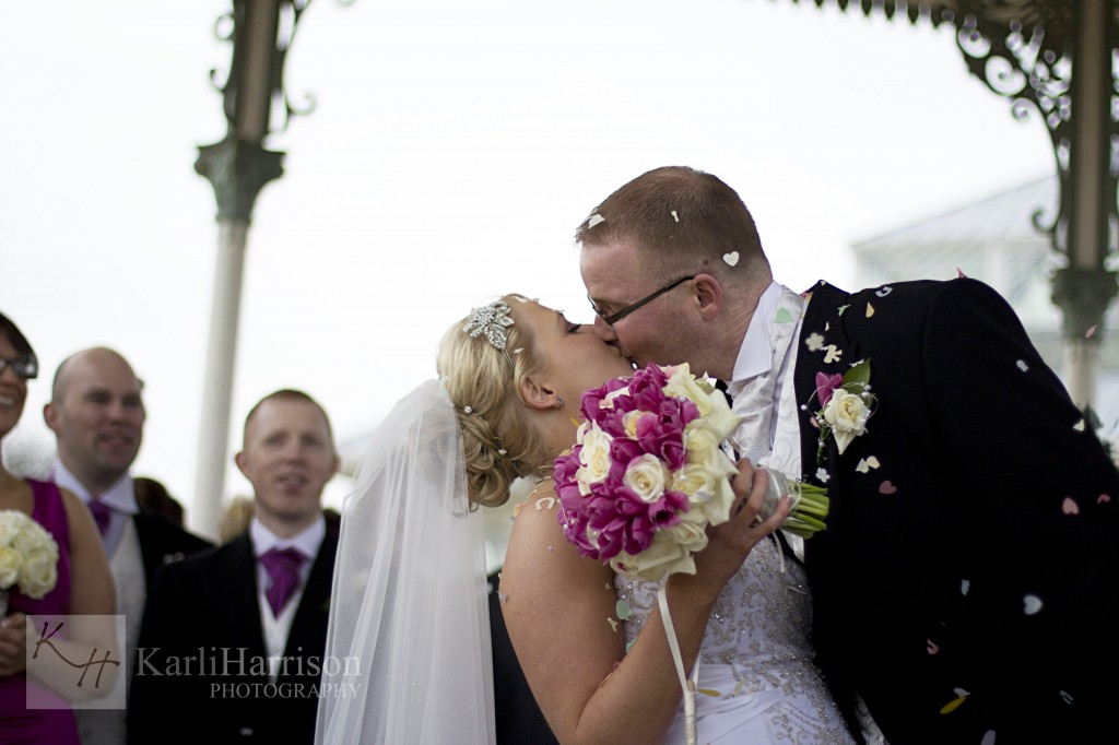 Bride and Groom Kissing during Confetti Shot, Isla Gladstone Liverpool Wedding