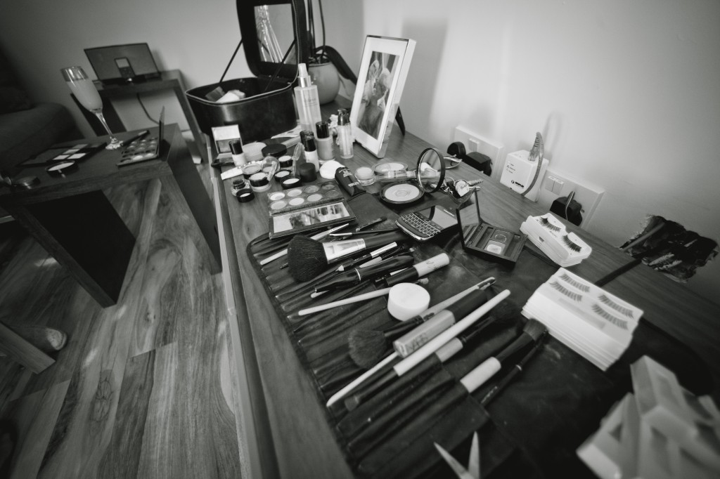 Wedding photojournalism, a wedding photograph of the make-up mess during bridal preparations