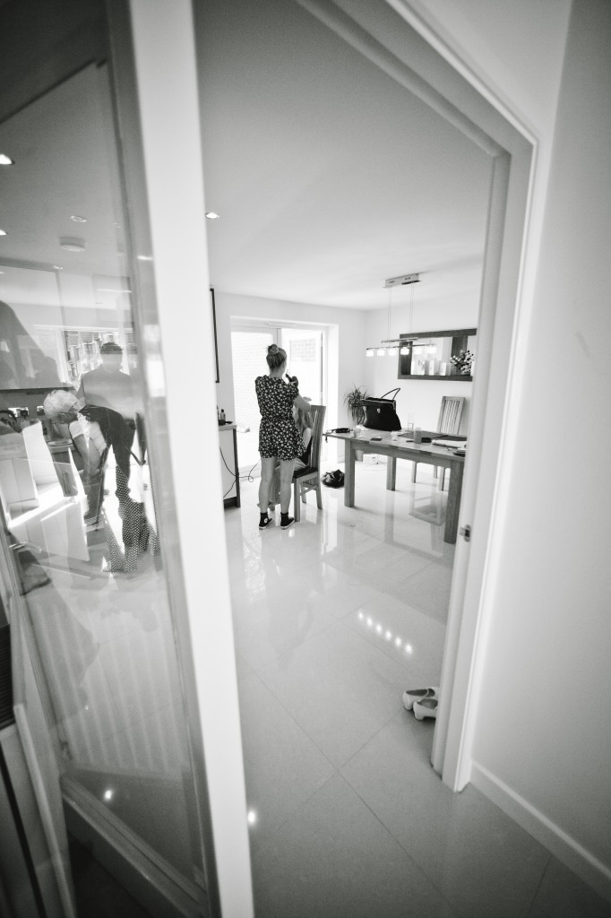 Documentary wedding photography, looking in with a wide angle lens to include doorway
