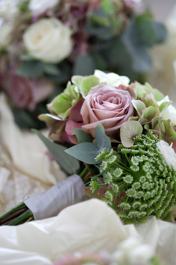 Gorgeous pink rose nestled in with other flowers in a bridesmaid bouquet, Lancashire wedding photography