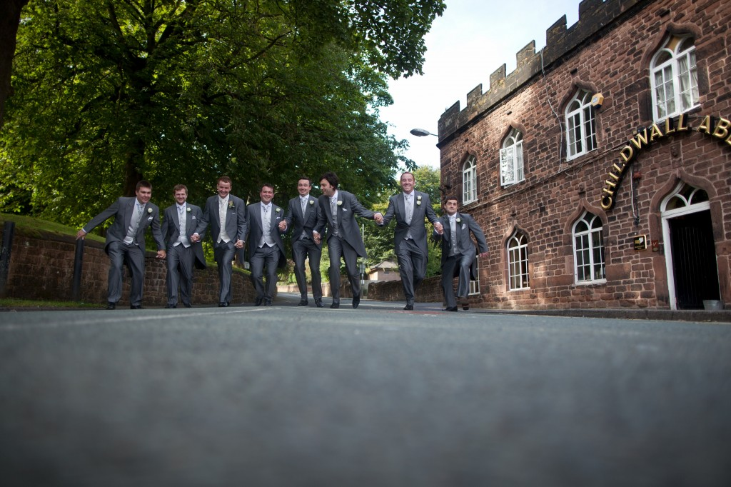 The groom and his men charging down the road