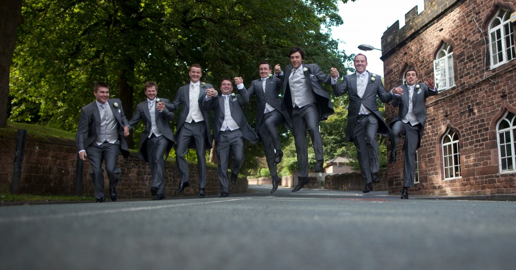 Jumping in the air, a groom and his grooms men Lancashire