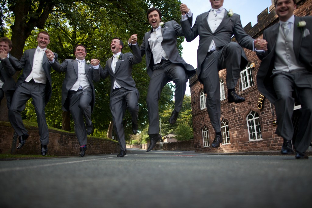 Nearly on top of me! The groom and his men charging over me as I crouch on the road. Creative wedding photography