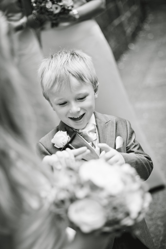 A little boy waiting for the bride to arrive at the church