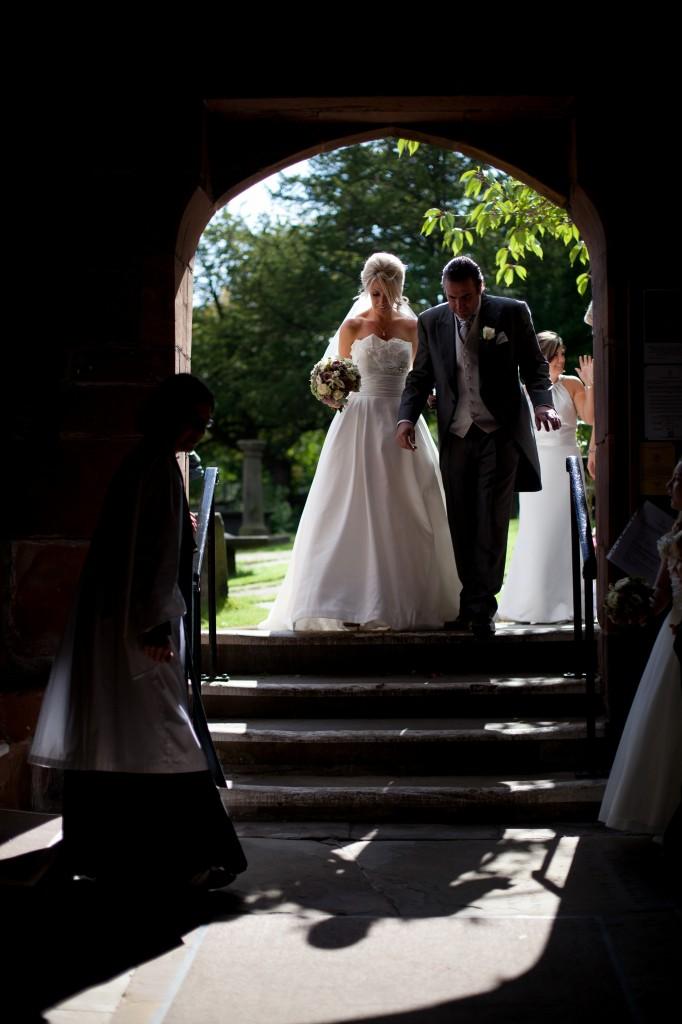 Walking into the church in Lancashire. Beautiful wedding photography