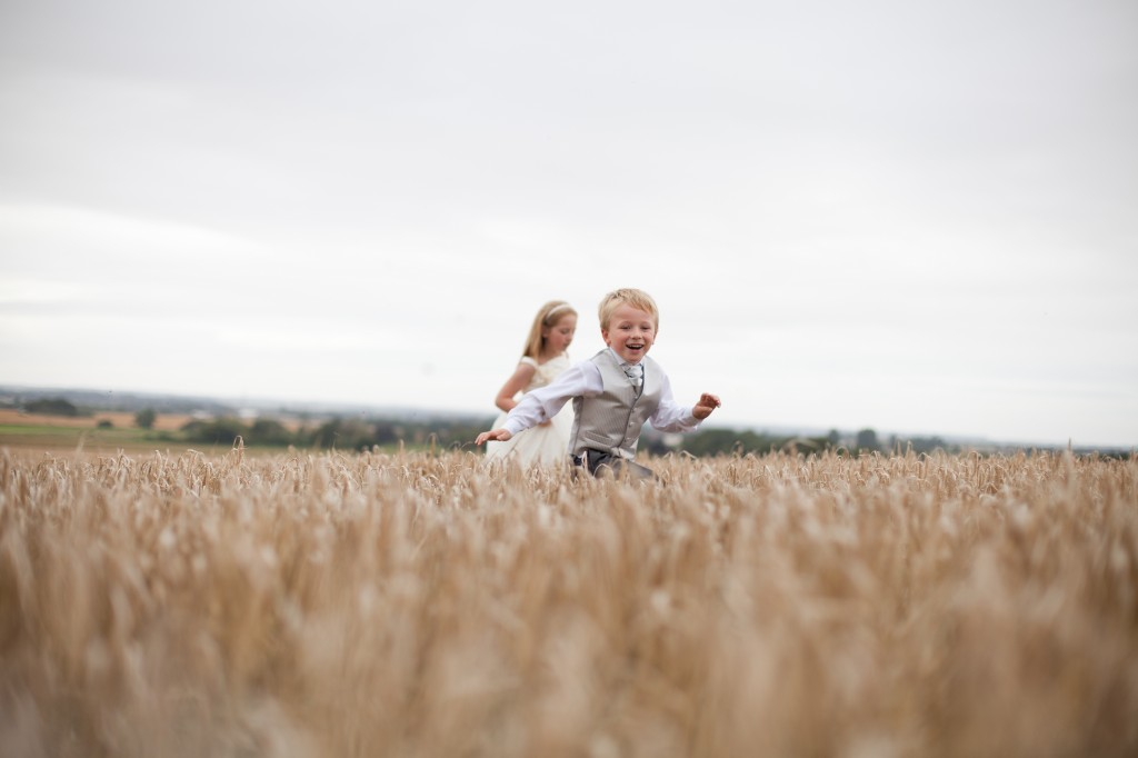 Boy and girl running across a field at West Tower, Lancashire Wedding Photography