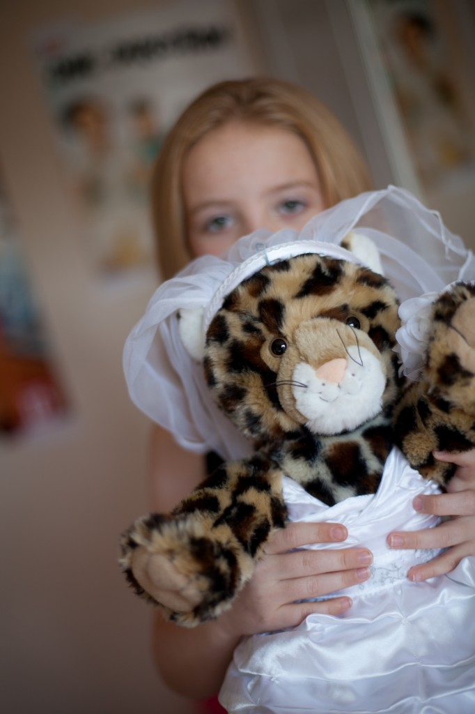 Bridesmaid and her bride cuddly toy. Creative Wedding Photography, Lancashire